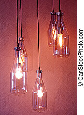 Hanging light bulbs, on red background.