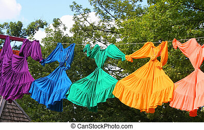 Hanging out - Bright colored dresses on clothesline