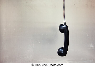 hanging phone receiver - Hanging vintage phone receiver over...