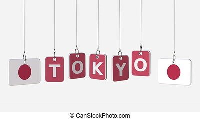 Hanging plates with flags of JAPAN and Tokyo caption....