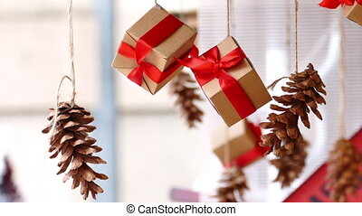 Hanging presents and pine cones - Hanging presents with red...