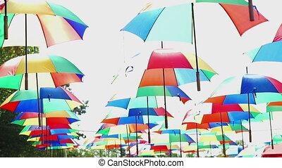hanging rainbow colored umbrellas - Street farm area...
