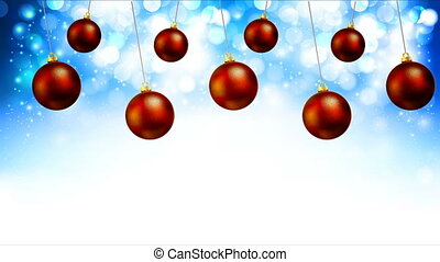 Hanging red Christmas balls on a shiny blue background bokeh