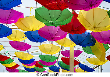 Hanging reversed umbrellas forming cover and roof