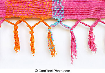 Hanging tassles - Woven coloured material with hanging...