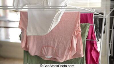 Hanging Up Washing - Hanging up washing on a clothes dryer