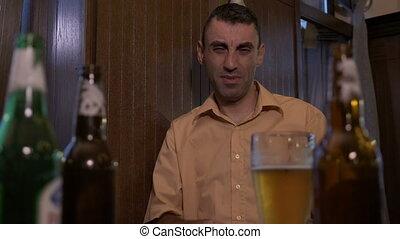 Hangover depressed man sitting at the bar after hard...