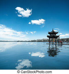 hangzhou china - ancient pavilion against a blue sky and...