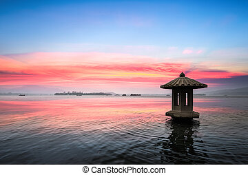 hangzhou landscape in sunset - sunset glow in the beautiful...