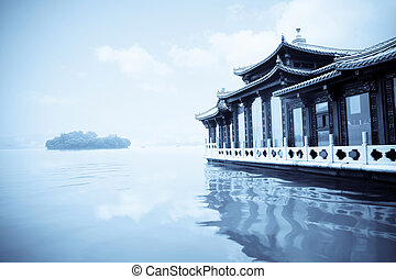 hangzhou landscape - traditional ship at the west lake...