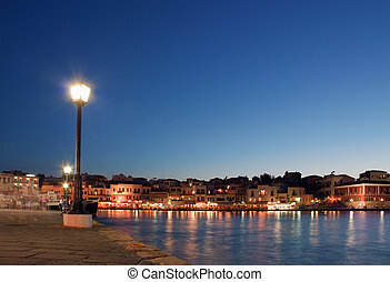 Hania harbor at sunset - Hania harbor promenade at sunset. ...