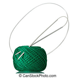 Hank of green cotton yarn and knitting needles isolated on...