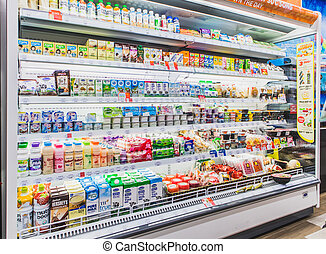HANOI,VIETNAM - March 1,2021 -Variety of Drinking yogurt, soy milk,milk and healthy drink on Freezer shelves at convenience store