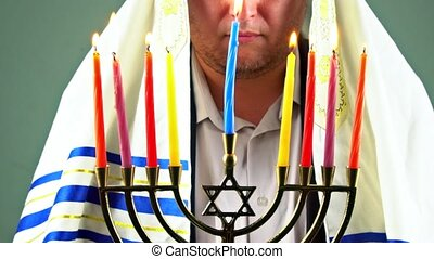 Hanukkah, a Jewish celebration. Candles burning in the...