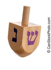 Hanukkah dreidel, isolated on white background.