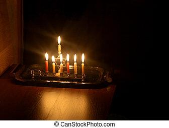 Hanukkah is a Jewish holiday. Burning Chanukah candlestick with candles. Chanukiah Menorah