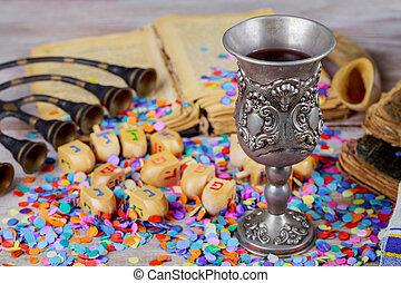 Hanukkah menorah of dreidels in rustic setting