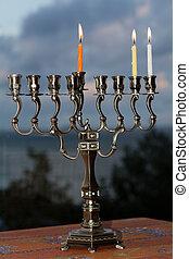 Hanukkah menorah on the second day of Hanukkah - Hanukkah...