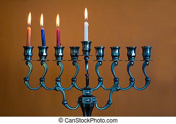 Hanukkah menorah on the third day of Hanukkah - Hanukkah...