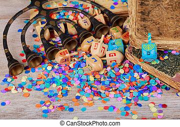 Hanukkah menorah with candles Grouping of Hanukkah dreidels in rustic setting