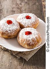 Hanukkah sufganiyot. Traditional Jewish donuts for Hanukkah.