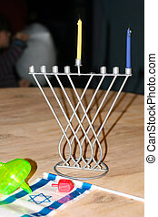 Hanukkah. The Israeli flag. Dreidl. Macro photography. -...