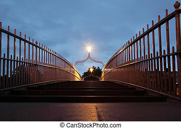 Ha'penny Bridge at night. Ha'penny Bridge is a pedestrian bridge built in 1816 over the River Liffey in Dublin, Ireland.