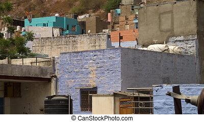 Haphazard, colorful buildings near Mehrangarh Fort - A wide...
