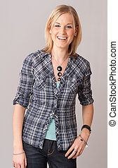 Happily laughing casual blonde - Portrait of an laughing...