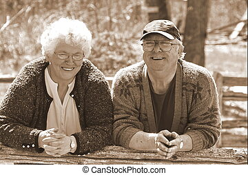 happily married couple - a senior married couple in sepia