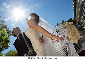 Happily Married Couple - Happy newly wed couple posing in...