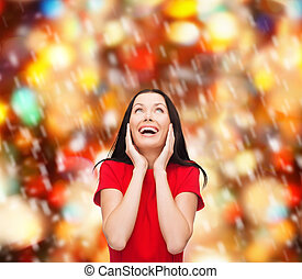 amazed laughing young woman in red dress