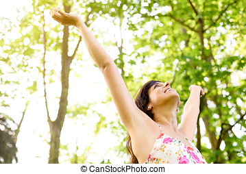 Happiness and relax on nature - Happy and carefree woman...