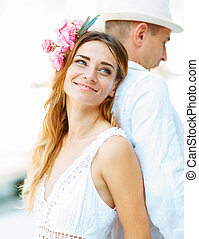 Happiness and romantic couple in summer sunlight