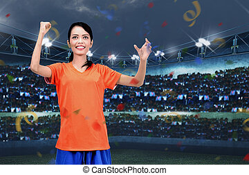 Happiness asian soccer player woman celebrate the win