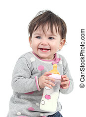 Happiness baby holding a feeding bottle on a white isolated background