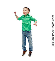 happy little boy jumping in air