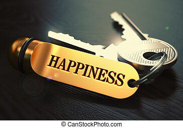 Happiness. Concept on Golden Keychain.