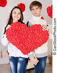 happiness couple holding big heart