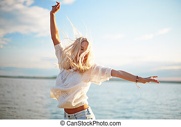 Happiness - Delighted blond girl enjoying summer rest
