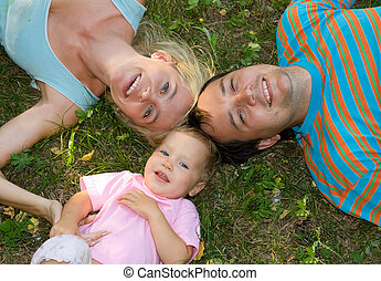 Happiness family on the grass