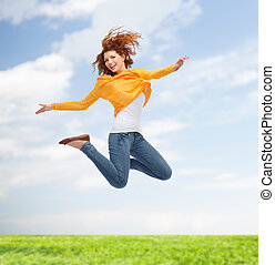 smiling young woman jumping high in air