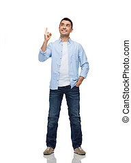 smiling man pointing finger up