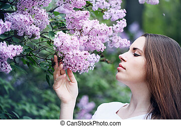 happiness Girl smelling a lilac
