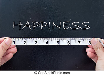 Happiness - Hands holding a tape measuring happiness