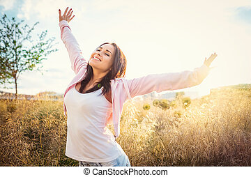 Happiness - Happy young girl in the field