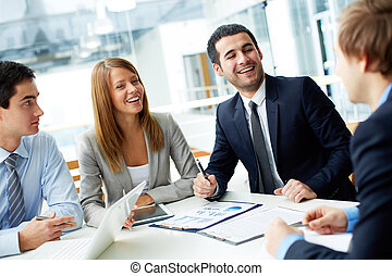 Happiness - Image of business partners laughing during...