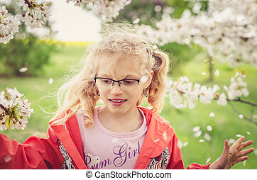 happiness in springtime in garden full of blossoming flowers