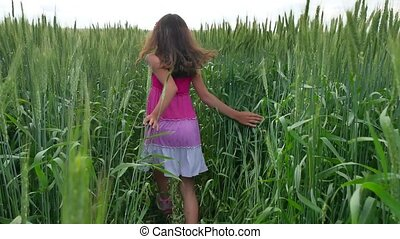 Happiness is childhood. A teenage girl teenager is running...