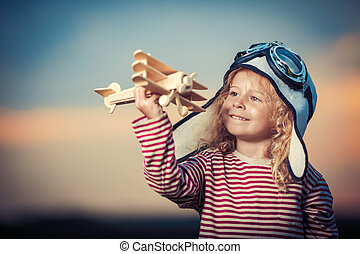 Happiness - Little girl with wooden plane